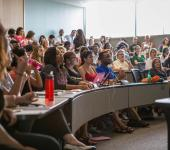 "Students and faculty listen to Jasmine Rand's presentation on ""Sexualizing Race, Gendering Sex: Stand Your Ground, Trayvon Martin and White Female Sexuality in the Prosecution of Black Men"""
